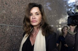 In this March 29, 2016, file photo, model Janice Dickinson leaves a hearing about her defamation lawsuit against Bill Cosby in Los Angeles Superior Court.