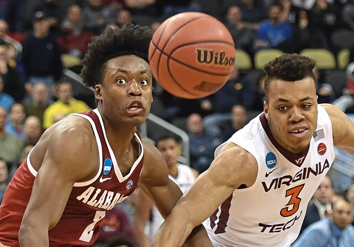 Alabama's Collin Sexton battles Virginia Tech's Wabissa Bede for loose ball during the first-round game in the NCAA men's college basketball tournament Thursday, March 15, 2018, at PPG Paints Arena in Pittsburgh. (Peter Diana/Post-Gazette)