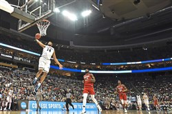Villanova's Omari Spellman dunks against Radford during a first-round game in the NCAA men's college basketball tournament Thursday at PPG Paints Arena.