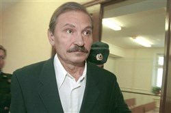 In this Dec. 19, 2000 file photo, ex-deputy director general of Aeroflot airlines company Nikolai Glushkov leaves the Lefortovsky court escorted by police officers, after the judge refused to release him on bail, in Moscow.