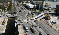 This photo provided by DroneBase shows the collapsed pedestrian bridge at Florida International University in the Miami area on Thursday.