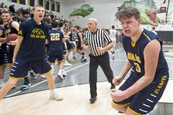 Mars Michael Carmody reacts after beating Highlands during the PIAA playoffs on Friday at Gateway High School. Mars won 60-51. (Steph Chambers/Post-Gazette)