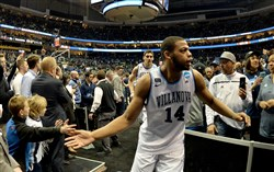 Villanova's Omari Spellman greets fans after defeating Alabama in the second round of the NCAA tournament Saturday at PPG Paints Arena.