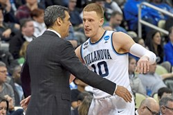 Villanova head coach Jay Wright reaches to hug Donte DiVincenzo as he exits the game in the second half of the Wildcats' win Saturday.