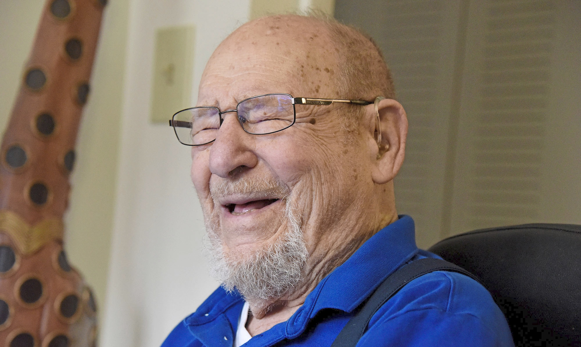 20180316dsSENIORACADEMY0319Local02-1 Al Fineman, 97, laughs as he sits in his living room at the Riverview Towers apartments in Squirrel Hill. He is part of the Jewish Healthcare Foundation-sponsored Virtual Senior Academy to use their home computers to take various online classes and interact with each other through the video conferencing.