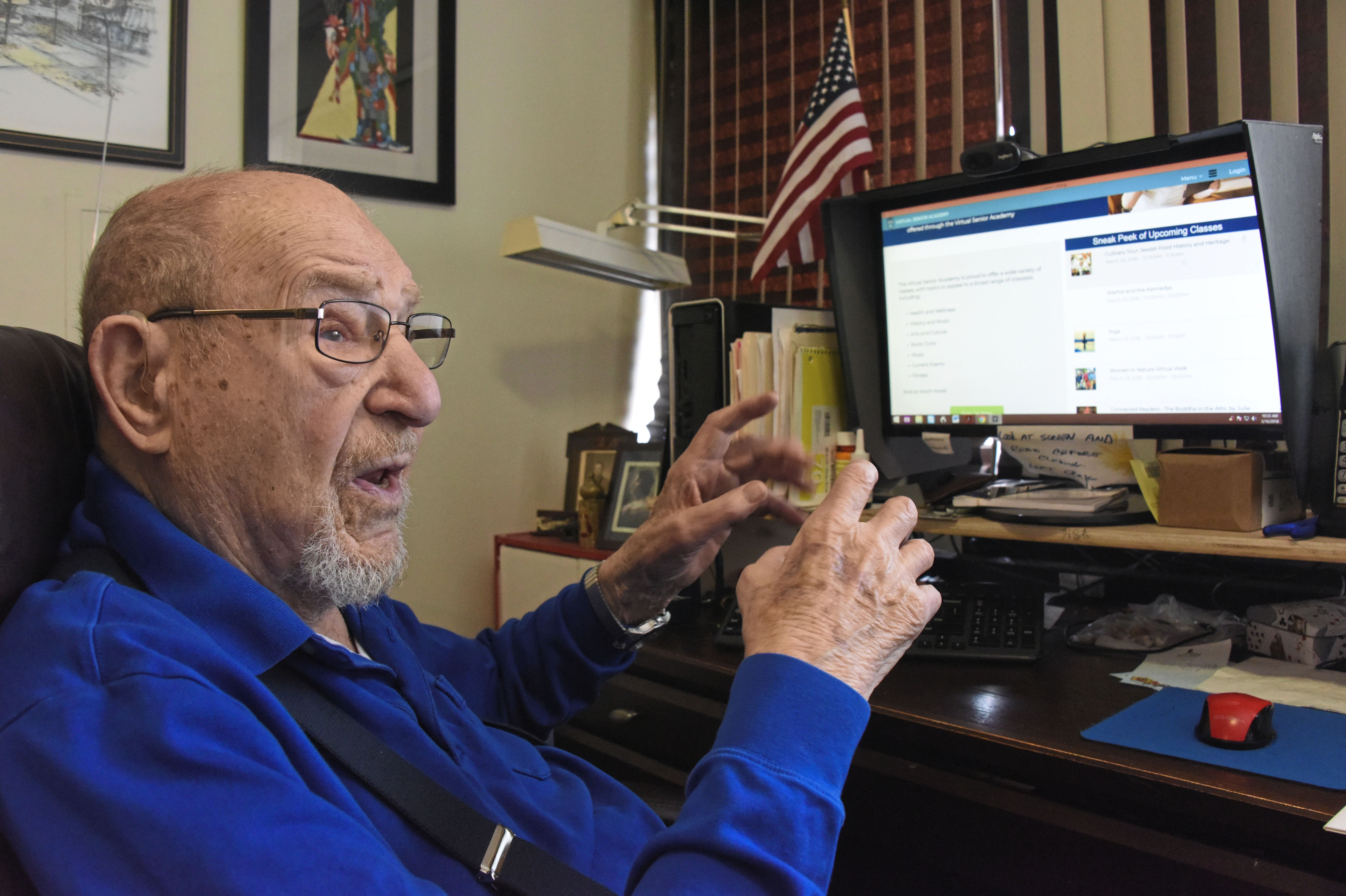 20180316dsSENIORACADEMY0319Local05-4 Al Fineman, 97, talks about his chatroom and using his computer in his living room at the Riverview Towers apartments in Squirrel Hill. He's part of the Jewish Healthcare Foundation-sponsored Virtual Senior Academy, using his home computer to take various online classes and interact with other seniors through the video conferencing.