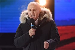 Russian President Vladimir Putin addresses the crowd during a rally and a concert celebrating the fourth anniversary of Russia's annexation of Crimea at Manezhnaya Square in Moscow on March 18, 2018.