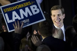 Conor Lamb, Democratic congressional candidate for Pennsylvania's 18th district, greets supporters at an election night rally March 14, 2018, in Canonsburg.
