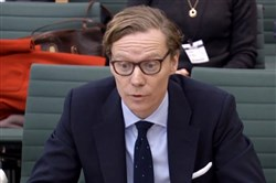This video grab from footage broadcast by the U.K. Parliament's Parliamentary Recording Unit on Feb. 27 shows the CEO of Cambridge Analytica, Alexander Nix, giving evidence to the Digital, Culture, Media and Sport Committee of members of Parliament on the subject of fake news at the Houses of Parliament in London.