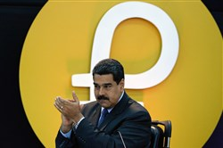 "In this file photo taken February 20, 2018, Venezuela's President Nicolas Maduro applauds during a press conference to launch a new oil-backed cryptocurrency called ""Petro"" at the Miraflores Presidential Palace in Caracas."