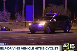 This March 19, 2018, still image taken from video provided by ABC-15 shows investigators at the scene of a fatal accident involving a self-driving Uber car on the street in Tempe, Ariz.