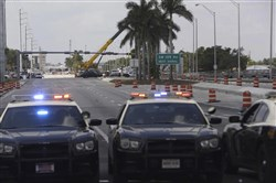 Florida Highway Patrol cars block the road near where the FIU pedestrian bridge collapsed March 19, 2018.