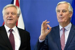 European Union chief Brexit negotiator Michel Barnier, right, gestures as he meets with British Secretary of State for Exiting the European Union David Davis at EU headquarters in Brussels on March 19, 2018.