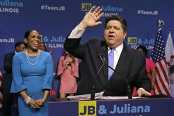 Democratic gubernatorial candidate J.B. Pritzker, right, celebrates winning the Democratic gubernatorial primary with lieutenant governor candidate Juliana Stratton on March 20, 2018, in Chicago.