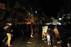 A handout picture released by the Syrian Arab News Agency on March 20, 2018, shows Syrians gathering at the site where a rocket hit a busy shopping area in Damascus' Jaramana area, in one of the deadliest rebel attacks on the Syrian capital.