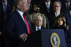 U.S. Attorney General Jeff Sessions watches as President Donald Trump speaks to supporters, local politicians and police officers at an event at Manchester Community College on March 19, 2018, in Manchester, New Hampshire.