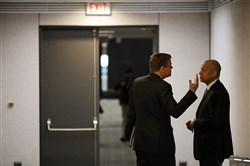 Senate Intelligence Committee ranking member Sen. Mark Warner, D-Va., left, talks with former Homeland Security Secretary Jeh Johnson before he testifies to the committee in the Hart Senate Office Building on Capitol Hill in Washington on March 21, 2018.
