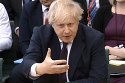 A video grab from footage broadcast by the U.K. Parliament's Parliamentary Recording Unit shows Britain's Foreign Secretary Boris Johnson giving evidence before the Foreign Affairs Committee at Parliament in London on March 21, 2018.
