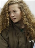 In this file photo taken December 28, 2017, Palestinian Ahed Tamimi appears at a military court at the Israeli-run Ofer prison in the West Bank village of Betunia.