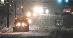 A salt truck makes its way along Brownsville Road in Brentwood Wednesday morning.