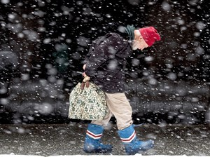 Philip Sidel, 86, of Squirrel Hill, carries his belongings as he makes his way to the Port Authority Downtown Service Center to ask how to find a bus back home on Wednesday, March 21, 2018, along Smithfield Street, downtown. Sidel said he took a bus to Pittsburgh to make his appointment with the IRS, but it was closed today. (Steph Chambers/Post-Gazette)