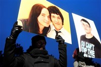 A protester holds up a photo of investigative journalist Jan Kuciak and his fiancee Martina Kusnirova. They were murdered late last month in Slovakia.