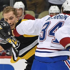 Pittsburgh Penguins' Jamie Oleksiak fights Canadiens Michael McCarron Wednesday, March 21, at PPG Paints Arena in Pittsburgh.