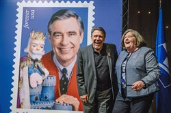 Photographer Walt Seng and Postmaster General Megan Brennan after the dedication of a new stamp honoring Fred Rogers at a ceremony in Fred Rogers Studio at WQED on Friday, March 23, 2018 in Squirrel Hill.