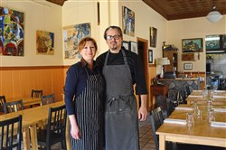 Yelena and Michael Barnhouse, owners of Lola Bistro, at the restaurant on Thursday, March 22, 2018, in the North Side.