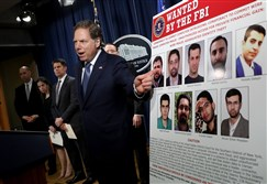 U.S. Attorney for the Southern District of New York Geoffrey Berman speaks at a press conference at the Department of Justice Friday in Washington, D.C. Deputy Attorney General Rod Rosenstein and other law enforcement officials announced a major cyber law enforcement action against nine Iranians charged with conducting massive cyber theft campaigns on behalf of the Islamic Revolutionary Guard Corps.