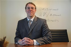 Bankruptcy attorney Matthew Brennan is pictured at his office on Friday, March 23, 2018 in East Liberty.