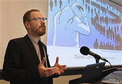 "Dr. Daniel Z. Buchman, a bioethicist and assistant professor with the University of Toronto, talks about ""opioid contracts"" during a conference at the University of Pittsburgh Friday."