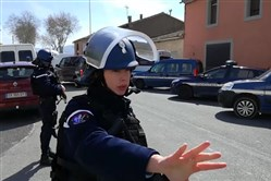 In this image taken from La Depeche Du Midi, police attend an incident in Trebes, southern France, Friday March 23, 2018. French counterterrorism prosecutors are taking charge of the investigation into the shooting of a police officer in southern France that has led to an apparent hostage-taking at a supermarket.