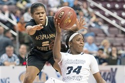 Neumann-Goretti's Kiara Koger defends Bishop Canevin's Bri Allen during the PIAA Class 3A girls basketball championship Monday in Hershey.