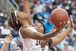 Bishop Canevin's Shamyjha Price shoots against Neumann-Goretti's Daijah Parmley during the PIAA class 3A girls basketball championship on Monday.