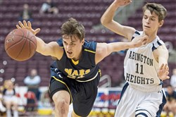 Mars' Robby Carmody reaches for the ball against Abington Heights' Corey Perkins during the PIAA class 5A boys basketball championship on Tuesday at the Giant Center in Hershey. Abington Heights won 67-55.