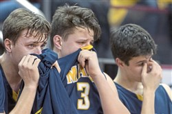 Mars brothers Robby and Michael Carmody, and teammate Cade Hetzler react as time winds down during the PIAA class 5A boys  championship. Abington Heights defeated Mars, 67-55.