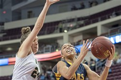 Archbishop Wood's Katie May fouls Mars' Tai Johnson, and her shot went in to take the lead in the game, during the PIAA class 5A girls basketball championship on Wednesday, March 28. Mars beat Archbishop Wood, 36-33.