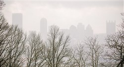 Downtown Pittsburgh is barely visible as seen from the North Side during a snow squall on April 5.