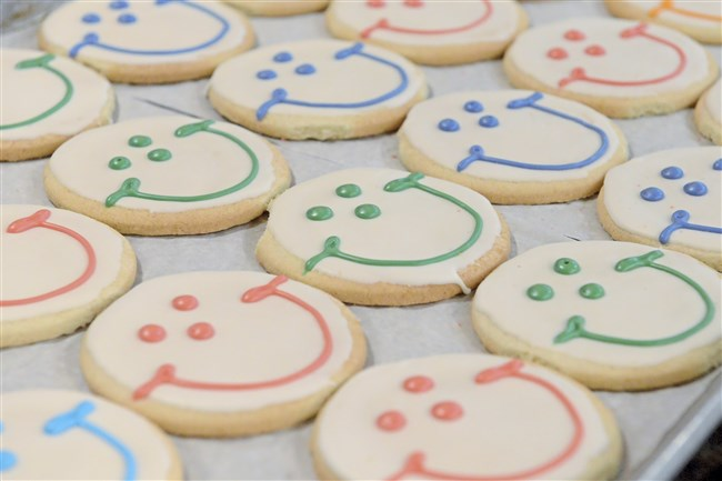 Freshly baked Smiley cookies lie in a tray at the Eat'n Park in Avalon on April 6, 2018.
