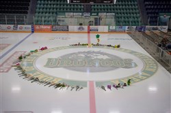 Flowers are shown at center ice as preparations are made at Elgar Petersen Arena for a vigil tonight in Humboldt, Saskatchewan, on April 8, 2018.