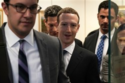 Facebook CEO Mark Zuckerberg, center, leaves after a meeting with U.S. Sen. Bill Nelson, D-Fla., ranking member of the Senate Committee on Commerce, Science, and Transportation, on Capitol Hill in Washington on Monday, April 9.