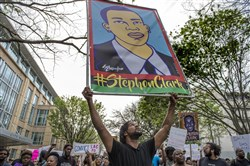 In this file photo, Andre Young, 25, leads a march during a Day of Action protest in downtown Sacramento hosted by Black Lives Matter Sacramento and the Anti Police-Terror Project in Sacramento, Calif., on April 4, 2018.