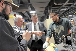 Daniel Moore Business Ken Broadbent, second from left, business manager of  the Pittsburgh Steamfitters Local 449 gives a tour to Jerry Oleksiak, the recently nominated secretary of the Pennsylvania Department of Labor and Industry, at the new Steamfitters Local Union 449 Technology Center while students Zac Lakenan, left, 22, and Shane Davis, 20 work on a motor on Tuesday, April 10, 2018 in Harmony, Butler County.