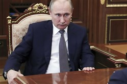 In this file photo, Russian President Vladimir Putin listens during a meeting in Moscow on April 14, 2018.