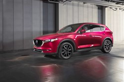 I couldn't help but seeing an old-style wagon – as in covered wagon – when looking at the giant wheels of the 2018 Mazda CX-5.