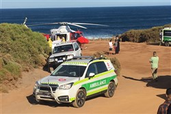 A rescue helicopter and other emergency vehicles are seen at the scene of the shark attack in Gracetown, Australia, on April 16, 2018.