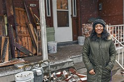 Desi-Rai LaPrade in front of a home she has been pre-approved to purchase in Garfield. She has been participating in Circles East Liberty and has used the help of people in the program to get financially stable and start saving.