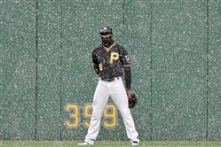 Pirates Starling Marte plays through a snow squall against the Rockies in the first inning Tuesday, April 17, 2018 at PNC Park. (Matt Freed/Post-Gazette)