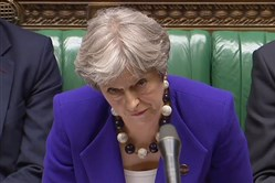 A video grab from footage broadcast by the U.K. Parliament's Parliamentary Recording Unit shows Britain's Prime Minister Theresa May listen as opposition leader Jeremy Corbyn speaks during the weekly Prime Minister's Questions in the House of Commons in central London on April 18, 2018.